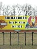 Here's the largest print of my artwork available... well at least the flaming eagle part. This was fun to see off to the side of Rte. 64 here in Virginia. If I climb up there and sign it, will it make the billboard more valuable?